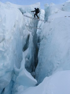 Tom crossing a crevasse in the Khumbu Icefall